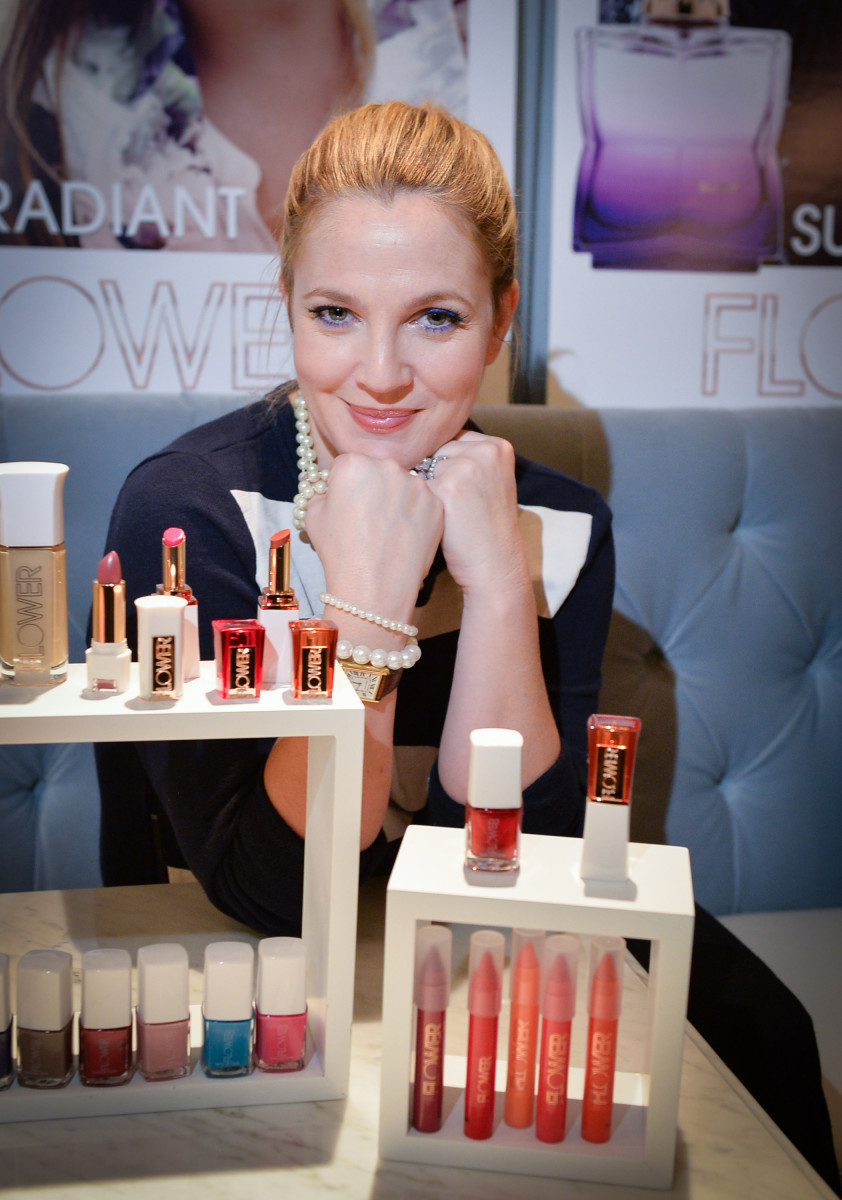 Drew barrymore on the launch of flower beauty in canada the drew barrymore posing with her flower beauty products izmirmasajfo